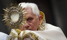 Pope Benedict: Hiding behind the cross.