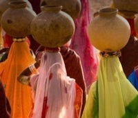 Water pots and veiled Rajastani women.