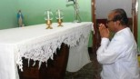 Poojary praying for Sonia-jee's god.
