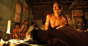 Ardiman, a ritual leader, chanted during a healing ceremony for a teenage girl a Tumbang Saan.