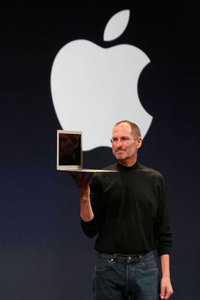 Steve Jobs showing off his MacBook Pro laptop computer.