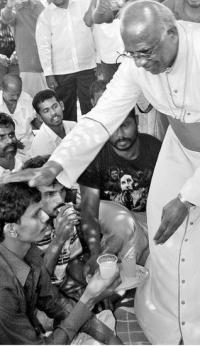 Bishop of Tuticorin Roman Catholic Diocese Rt. Rev. Yvon Ambroise offering juice to a protester at Idinthakarai on Thursday. — Photo: A. S.