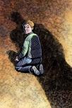 Boy in the dark shadow of a predatory priest.