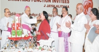 Mylapore Archbishop A.M. Chinnappa feeding Christmas cake to Chief Minister Jayalalithaa.
