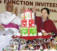 Tamil Nadu Chief Minister Jayalalithaa cuts Christmas cake as Archbishop Chinnappa looks on.