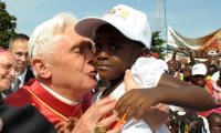 Pope kissing boy: Look at the boy's expression!