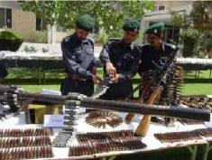 Pakistan police inspecting arms confiscated in NW Frontier Province.
