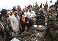 President Patel with AK-47