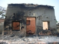 Burned-out Hindu house in West Bengal.