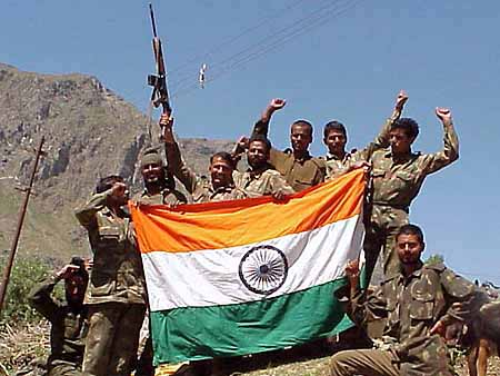 Indian soldiers with tri-colour in Kargil.