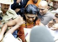 Nithyananda being arrested at the court in Ramananagara, Karnataka