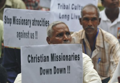 Tribals from various states of India hold placards during a protest against Christian missionaries in New Delhi in 2011. The demonstrators appealed to authorities to protect the culture of indigenous people, claiming that evangelical Christian missionaries are forcing them to convert to Christianity.