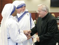 Fr. Donald  McGuire with Missionary of Charity nuns.