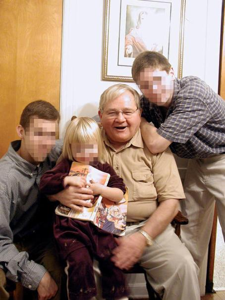 Fr. Donald McGuire SJ with his boys in 2002.