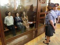 Pussy Riot members in a holding cage before their trial in July 2012.