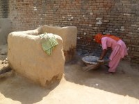 Dalit woman cleaning a dry latrine
