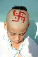 Boy with swastika
