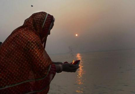 Pilgrim offering a lamp to Ganga Devi at Prayag
