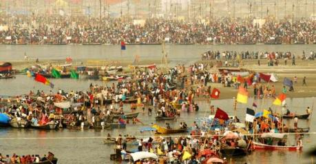Pilgrims bathing at the Triveni Sangam