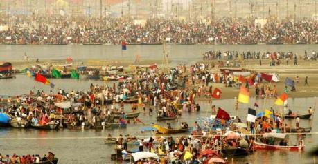 Pilgrims bathing at the Triveni Sangam