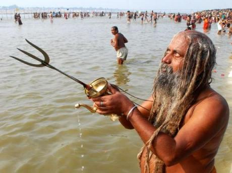 Sadhu bathing at Sangam