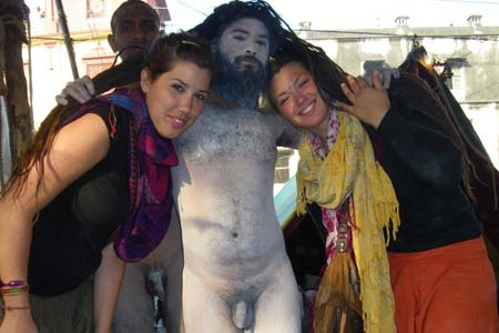 Naga sadhu with foreign tourists at Kumbha Mela 2013