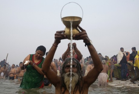 Sadhu offering water to the sun at the Kumbh Mela (2013)