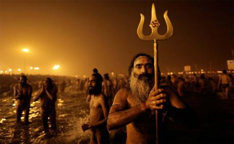 Naga sadhus bathing at the Kumbha Mela 2013