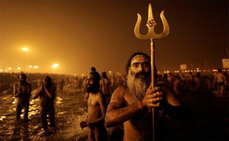 Naga sadhus bathing at the Kumbha Mela 2013