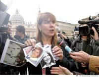 Victims of clerical sex abuse protest in front of Vatican.