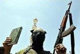 Jihadi: Koran in one hand, AK-47 in the other!