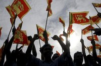 Srilankans celecbrate the defeat of the LTTE