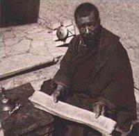 Tibetan lama with scroll.