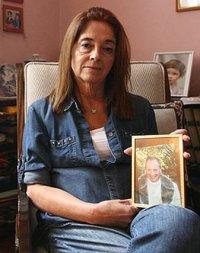 Graciela Yorio holding photo of her tortured Fr. Orlando Yorio SJ