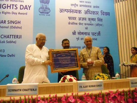 Fr. Ajay Kumar Singh receives award from UPA's Minority Commission