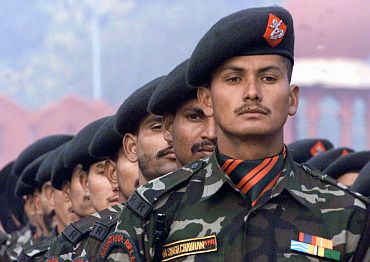 Indian soldiers from the Rashtriya Rifles take part in a full dress rehearsal in New Delhi January 13, 2003.