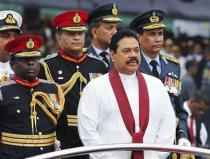 Sri Lanka's President Mahinda Rajapaksa inspects troops from an army vehicle during a war victory ceremony in Colombo.
