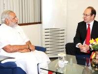 UK High Commissioner James Bevan speaks with Narendra Modi