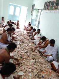 Counting the donations in a temple hundi.