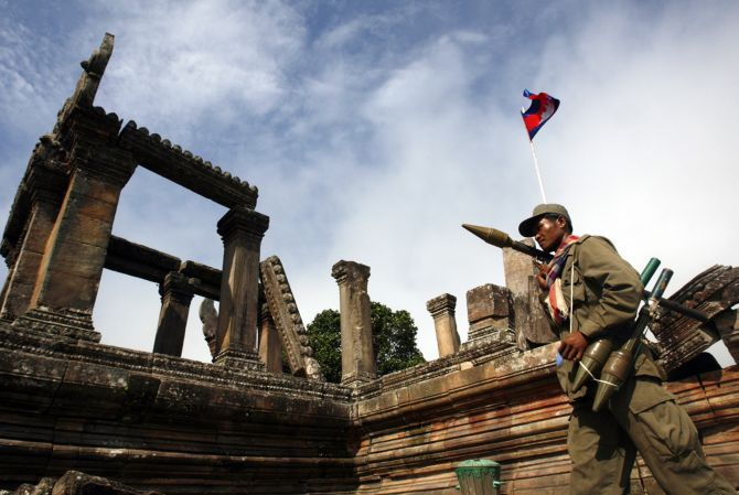 Cambodian soldier patrols at Preah Vihaer temple.