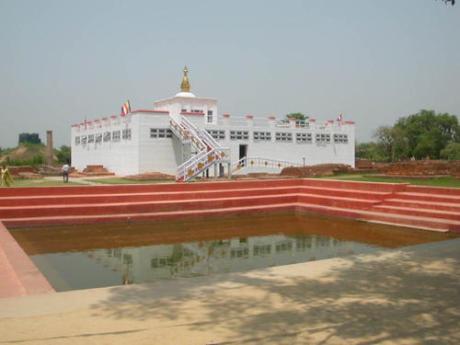 Maya Devi Temple with the Ashoka Pillar on the left.