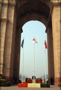 Flags of three armed forces with soldier at India Gate in New Delhi