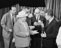 Soviet Premier Nikita Khrushchev and United States Vice President Richard Nixon debate the merits of communism versus capitalism in a model American kitchen at the American National Exhibition in Moscow in July 1959.
