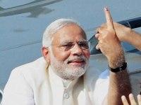 Modi's inked finger after voting in Varanasi