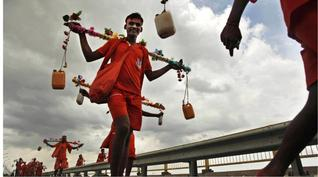 Pilgrim--called a kanvaria--carrying Ganga Jal to his home a 100 kms away