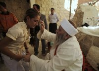 Yazidi holy man blessing a devotee at Lalish