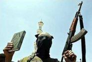 Jihadi with a Koran and AK 47