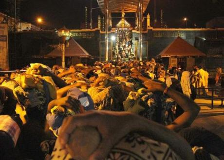 Pilgrims wait to climb the 18 steps at Sabarimala