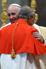 Pope Francis hugs Cardinal Albert Malcolm Ranjith Patabendige Don, Archbishop of Colombo, at St Peter's Basilica, on February 8, 2014 at the Vatican. AFP PHOTO / GABRIEL BOUYS