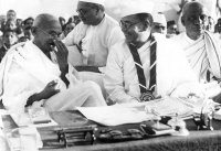 Members of the Indian National Congress (foreground left to right)  Mahatma Gandhi (Mohandas Karamchand Gandhi, 1869 - 1948), Subhas Chandra Bose (1897 - 1945) and Vallabhai Patel (1875-1950) during the 51st Indian National Congress in Haripura (1938).
